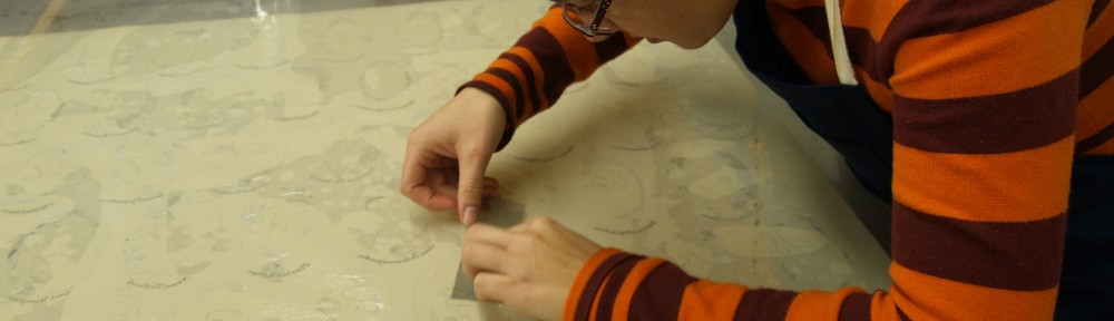 Image showing Lisa Duncan performing conservation treatment on the paper support of a photo assemblage.